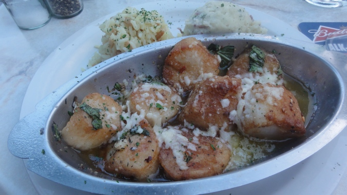 Parmesan-encrusted scallops with rice pilaf and parmesan mashed red bliss potatoes