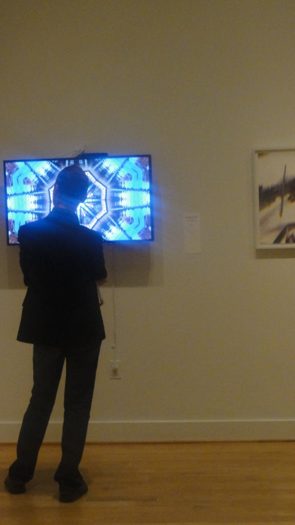Thibaut is mesmerized by a kaleidoscopic image of the iconic factory in downtown Providence
