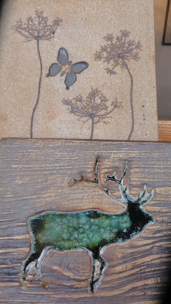 Ceramicist out of New Hampshire who uses natural materials to press into clay slabs, brushes with iron oxide.