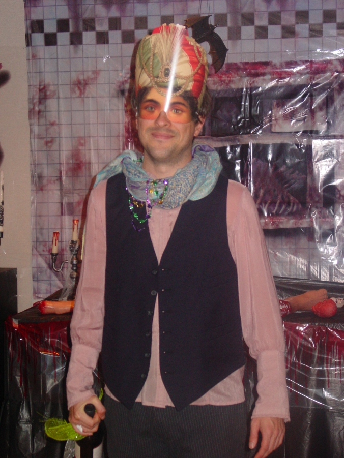 Matt as the fortune teller wearing a blouse from J. Jill, Mardi Gras beads, vest and boots a la Goodwill, and a one-of-kind smile