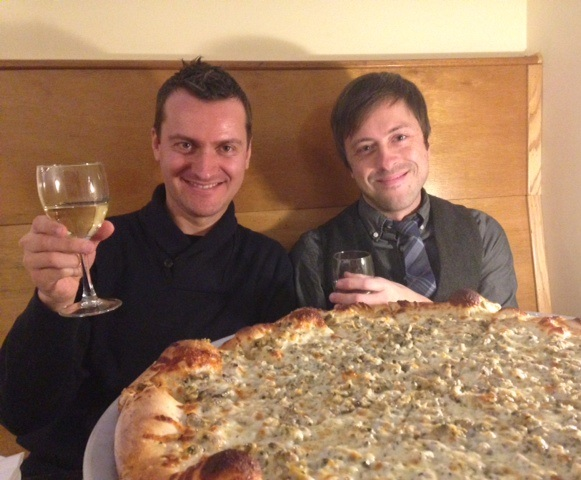 Thibaut and I behind a sea of Clam Pizza